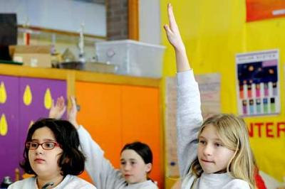 Fifth-graders take part in a science lesson at Webster's St. Rita School in January 2009.