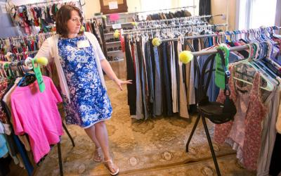 <p>Michaela Cortright talks about Catholic Charities of Tompkins/Tioga's clothing closet during the Ithaca agency's 20th-anniversary open house July 18. </p>
