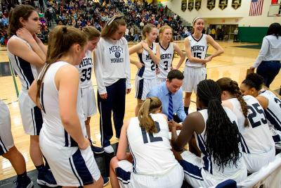Mercy Head Coach Tom Vasey talks to his team at the start of halftime