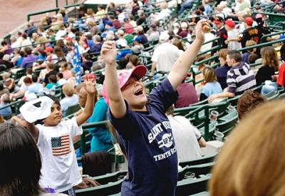Six-year-old Daniella Thompson, who will be a first-grader at Chili's St. Pius Tenth School in the fall, jumps for a balloon in the stands during Catholic Schools Night at Rochester's Frontier Field June 26.