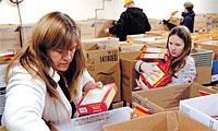 Life Solutions of Hamlin volunteers Lynn Piskorowski (left) and Kayla Breeze help fill meal boxes in 2007.