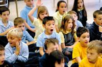 First-grader Ben Daino (center) and his classmates make their best expressions of surprise during a reading by Canandaigua author Donna Mirsky Bennett Dec. 3 at St. Mary School.
