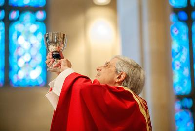Bishop Salvatore R. Matano elevates the chalice during a Nov. 6 Mass at Rochester's Sacred Heart Cathedral.