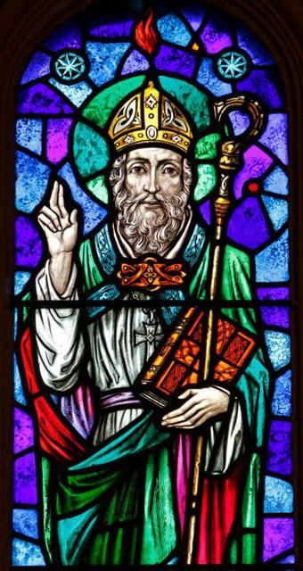 "St. Patrick is depicted in a stained-glass window at St. Aloysius Church in Great Neck, N.Y. Archbishop Eamon Martin of Armagh, Northern Ireland, said that ""as Irish people, we cannot think of St. Patrick without acknowledging the enormous humanitarian and pastoral challenges facing growing numbers of people who find themselves displaced and without status in our world."""