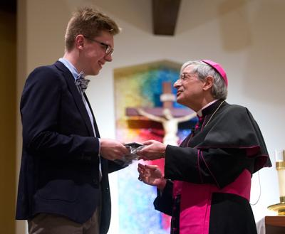 Bishop Salvatore R. Matano presents Andrew Kelemen of Church of the Assumption Fairport with the Hands of Christ Award during the annual Hands of Christ Recognition Ceremony held at St. John of Rochester on Wednesday, Feb. 8, 2017 in Fairport.