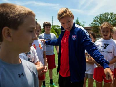 Lori Chalupny, a midfielder with the U.S. women's national soccer team competing in the World Cup in Canada, instructs fourth- and fifth-graders on a field at Nerinx Hall Catholic High School in St. Louis May 19.