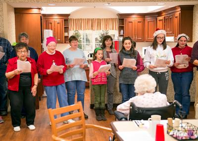 Parishioners from Geneseo's St. Luke the Evangelist Parish perform Christmas carols for residents at Livingston County Center for Nursing and Rehabilitation in Mount Morris Dec. 6.