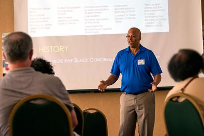 David Powe speaks on the history of the National Black Catholic Congress during a Day of Reflection at Rochester's Bishop Hickey Conference Center Aug. 27.