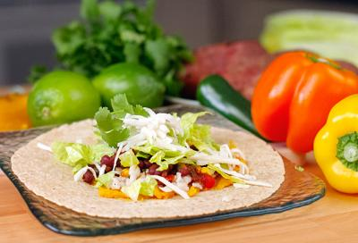 Black bean and corn tacos are a fast, easy-to-prepare option for meatless meals.