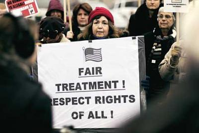 Marilu Aguilar joins protesters outside the U.S. Border Patrol station in Irondequoit during a Dec. 14 rally to call attention to the need for immigration reform.