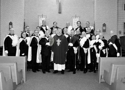 Master of the Fourth New York District Alan Frisa of Gates (front center row, from left); Father Michael Schramel, pastor of St. Jude the Apostle Parish, Gates; and District Marshall Scott Powell of Cheektowaga are shown with members of the Knights of Columbus Fourth Degree Honor Guard from the Fourth New York District.