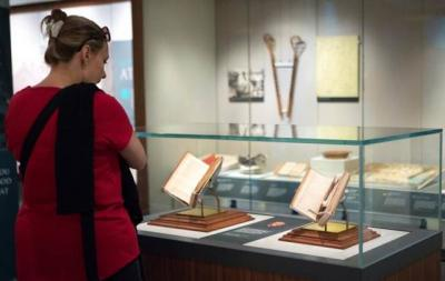 """Visitors at the Smithsonian Institution's National Museum of American History in Washington check out the exhibit """"Religion in Early America"""" July 26. The exhibit will be on display until June 3, 2018."""