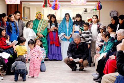 Parishioners from St. Maximillian Kolbe gather with the Mexican community to celebrate the tradition of Las Posadas in this Dec. 2010 file photo taken at St. Gregory Church in Marion.