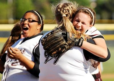 Aquinas softball player Paige Monachino (right) hugs teammate Gabrielle Sereika after Aquinas defeated Penn Yan 3-1 to clinch the Section 5 Class B1 title June 2 at Monroe Community College.