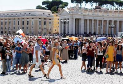 <p>People attend the Angelus prayer on the feast of the Assumption, Aug. 15, at the Vatican.  </p>
