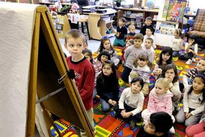 Students work on a lesson in Diane Albert's kindergarten classroom at Greece's St. Lawrence School in this file photo from January 2009.