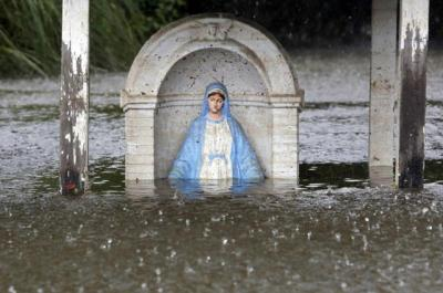 A statue of Mary is seen partially submerged in flood water in Sorrento, La., Aug. 20.