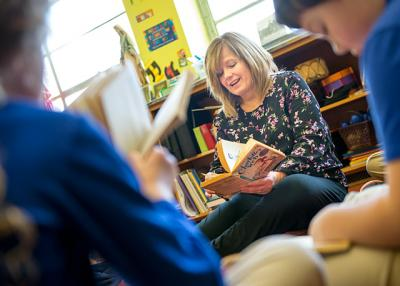 A longtime teacher at All Saints Academy in Corning, Kathy Boderick leads a class in a book discussion at the school on Jan. 20.