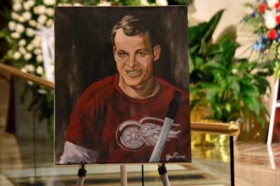 """A portrait of Detroit Red Wings great Gordie Howe is displayed next to his casket June 15 inside the Cathedral of the Most Blessed Sacrament in Detroit. Howe, the man forever known as """"Mr. Hockey,"""" died June 10 at age 88."""