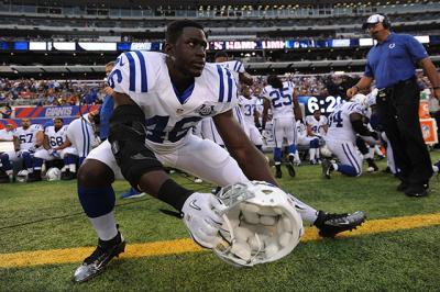 Indianapolis Colts linebacker Daniel Adongo stretches before a pre-season game at MetLife Stadium in East Rutherford, N.J., last year. The lifelong Catholic and native of Kenya has depended upon his faith to guide him through his first year as a professional football player and an injury that sidelined him for the 2014 season.