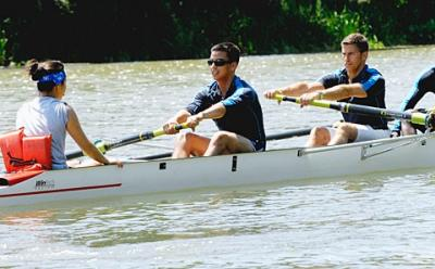 Oscar Pedroso (center) and Mark Johns, members of Cross Currents Minority Rowing, compete in a four-man sprint at the inaugural U.S. Rowing Diversity Invitational regatta July 30 on the Genesee River.