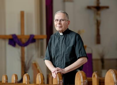 Father Lou Vasile, longtime pastor at Auburn's St. Alphonsus Church, will retire at the end of June.