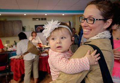 Alecia Neuroth and 7-month-old Elianna Neuroth attend the 10th-anniversary celebration for Rochester's Focus Pregnancy Help Center June 27.