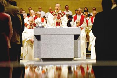 Bishop Matthew H. Clark celebrates a Rite of Dedication Mass in January 2005 that marked the reopening of Sacred Heart Cathedral after the building underwent extensive renovations.