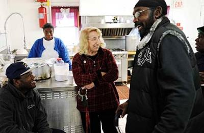 House of Mercy volunteer John Donaldson (lower left), founder and director Sister Grace Miller (center) and staff member C.W. Earlsey share a laugh Nov. 30.