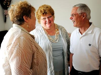 Jann Armantrout (center), diocesan life-issues coordinator, talks with Birthright of Rochester Director Joan Rohr (left) and Dean Hamingson during an Aug. 17 open house for Birthright's office in Gates.