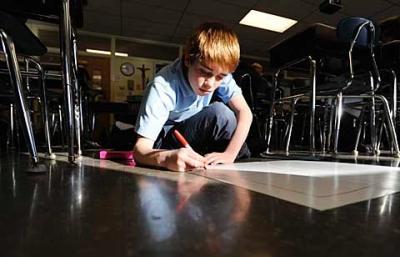 Greg Sanders works on a project at St. Joseph School in Penfield Jan. 20.