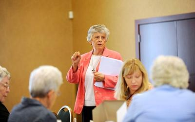 Sister of St. Joseph Beth LeValley (center) talks about federal legislation related to human trafficking during a Sept. 23 public-policy luncheon at the diocesan Pastoral Center.