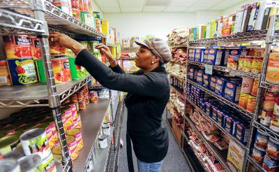 Tracy Williams works in the food pantry at Catholic Family Center's Community Resource Services branch in Rochester in 2010.