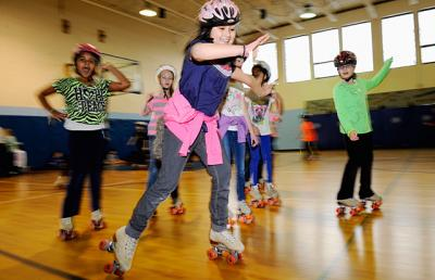Students at St. Lawrence School in Greece enjoy a roller-skating party during Catholic Schools Week in January 2013.