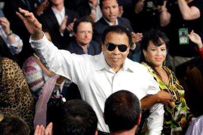 Boxing legend Muhammad Ali stands with his wife, Yolanda, as he is introduced before the 2010 welterweight fight between Floyd Mayweather Jr. and Shane Mosley at the MGM Grand Garden Arena in Las Vegas. Ali died June 3 at age 74 after a long battle with Parkinson's disease.