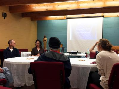 Shannon Loughlin (back) leads a June 12 discussion with high-school seniors, college students and parents about how to keep the faith while in college.
