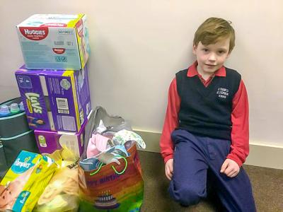 Roman Nearpass, 8, a student at St. Francis-St. Stephen School in Geneva, asked the guests at his recent birthday party to bring donations for Geneva's Family Hope Center instead of gifts for him.