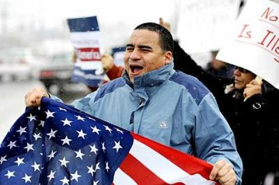 """Saul Linares of Hempstead, N.Y., takes part in an immigration-reform rally outside the Greece office of Congressman Chris Lee Feb. 17. The rally was part of the five-day """"New York Road Trip for Our Future,"""" whose participants support comprehensive immigration reform."""