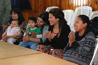 Young mothers gather in late October at Immaculate Heart of Mary Parish in Buenos Aires, Argentina, to discuss with Gravida volunteers topics ranging from diaper changes and pacifiers, to going out to dance for the first time since the birth of their baby. Gravida is an organization that supports pregnant women and young mothers.