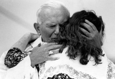 Pope John Paul II hugs a weeping young woman with cerebral palsy during World Youth Day in Denver in 1993.