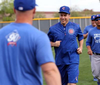 Father Burke Masters, Chicago Cubs' chaplain, takes part in a practice with players during spring training in March 2016 at Sloan Park in Mesa, Ariz. Cubs Manager Joe Maddon invited Father Masters to practice with the team.
