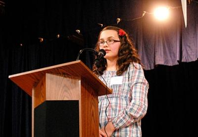 Isabel Jones, a sixth-grader at Pittsford's St. Louis School, spells a word during the third-annual Sister Mary Smith Invitational Spelling Bee at St. Mary School in Canandaigua March 16. Isabel went on the win the competition.