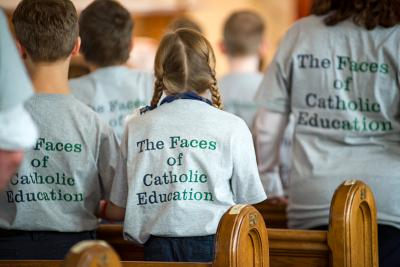 Students from Auburn's St. Joseph School and Tyburn Academy of Mary Immaculate wear matching shirts during a Feb. 3 Mass at St. Alphonsus Church.