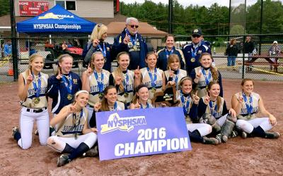 Elmira Notre Dame softball players pose with the championship plaque after they won the state Class C title June 12.