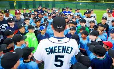 Retired professional baseball player Mike Sweeney addresses campers during his Catholic Baseball Camp near Seattle.
