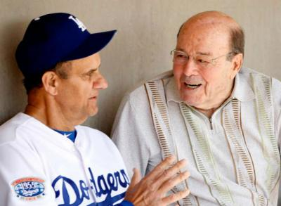 Los Angeles Dodgers head coach Joe Torre talks to Joe Garagiola before playing the Chicago White Sox in a 2010 spring training baseball game in Glendale, Ariz. Garagiola, a legendary broadcaster and former baseball player, died March 23 at age 90 in Scottsdale, Ariz.