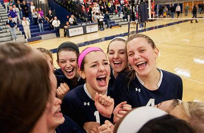 Members of Our Lady of Mercy High School's volleyball team celebrate after defeating Penfield to claim the Section 5 Class AA title Nov. 1 at Gates-Chili High School.
