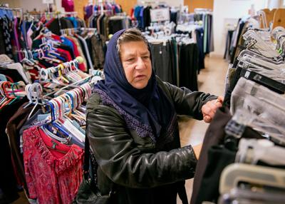 Hildamina Ibrahim looks through clothing at Matthew's Closet in Rochester Nov. 15.