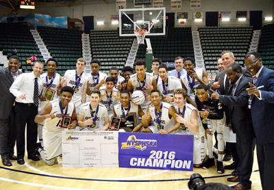 Aquinas Institute players and coaches pose with the championship plaque after winning the NYSPHSAA Class AA boy's basketball final March 13.