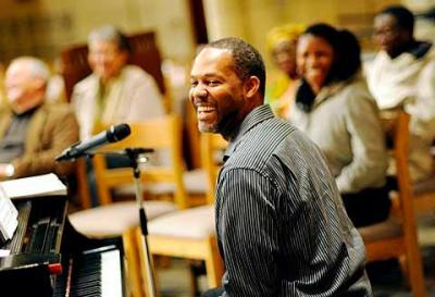Composer and pianist M. Roger Holland II helps lead the Diocesan Multicultural Conference's Oct. 22 opening prayer service at Sacred Heart Cathedral.